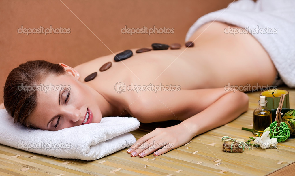 Stone therapy. Woman getting a hot stone massage at spa salon — Stock Photo #10949492