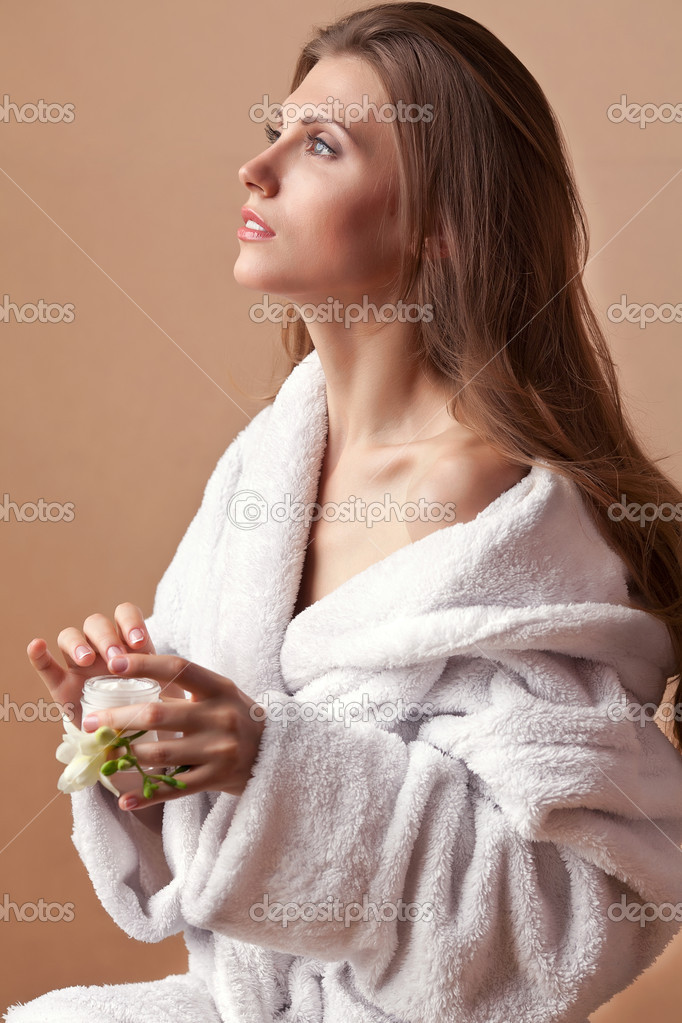 Skin care, portrait of beautiful woman with cream  Stock fotografie #10949590