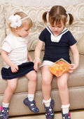 Two little girls with candies — Stock Photo
