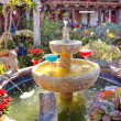 Fountain Margarita Glasses Flowers Garden Cactus Old San Diego C - Stock Photo