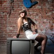 Girl on TV receiver — Stock Photo