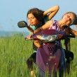Two young girls playing outdoor on scooter — Stock Photo