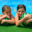 Two little girls playing in the bassin — Stock Photo