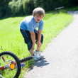 Boy with a bicycle — Stock Photo