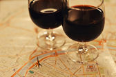 Wine in two wineglasses standing on the map of Paris — Stock Photo