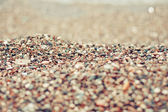 Background of smooth colorful beach stones — Stock Photo