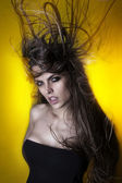 Beautiful attractive sexy young Brazilian fashion model with hair blown by wind — Stok fotoğraf