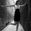 Royalty-Free Stock Photo: German blonde tall fashion model in a London Passing Alley posing wearing black white dress