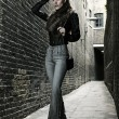 German blonde tall fashion model in a London Passing Alley posing wearing urban outfits — Stock Photo