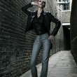 Royalty-Free Stock Photo: German blonde tall fashion model in a London Passing Alley posing wearing urban outfits