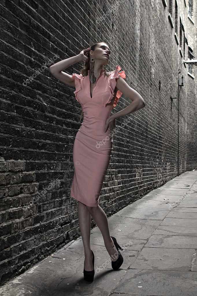 German blonde tall fashion model in a London Passing Alley posing wearing pink white dress — Stock Photo #11990519