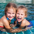 Two little girls playing in the pool — Stock Photo #11172806