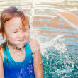 Little girl in the pool — Stock Photo