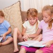 Children are reading the book — Stock Photo #11184081