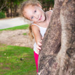 Girl hugging a tree — Stock Photo #11184311