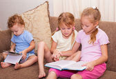 Children are reading the book — Stock Photo