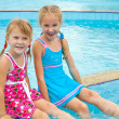 Two little girls playing in the pool — Stock Photo #11191666