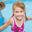 Two little girls playing in the pool — Stock Photo #11192055