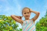 Happy child near a tree — Stock Photo