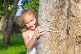 Girl hugging a tree — Stock Photo