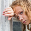 Sad little girl on the background of an old wall — Stock Photo #11342149