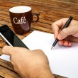 Blank white paper with pen and a mobile phone — Stock Photo #11342347
