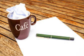 Blank white paper with pen and a cup of coffee — Stock Photo