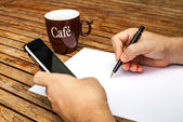 Blank white paper with pen and a mobile phone — Stock Photo