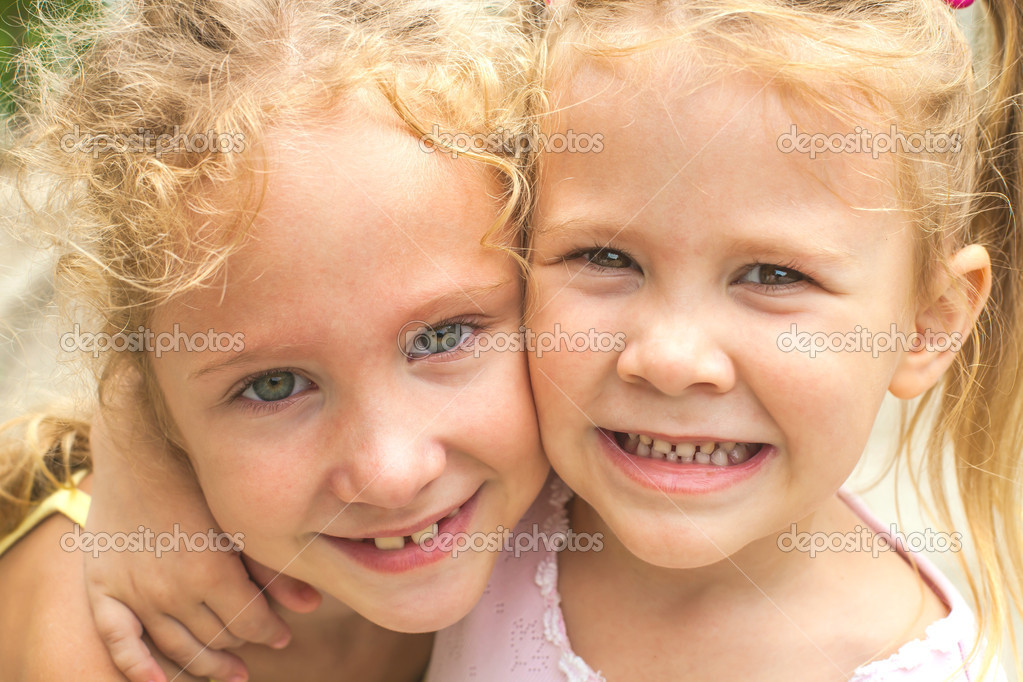 Portrait of  two happy sisters. — Stock Photo #11342039