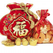 Red Gift Bags and Gold Ingots — Stock Photo
