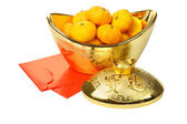 Mandarin Oranges in Gold Ingot and Red Packets — Stock Photo