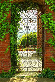A gate in leafs — Stock Photo