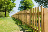 Woody fence in park — Stock Photo