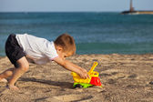 Child pushing his car toy on Lanzarotes beach — Stock Photo