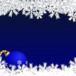 Christmas background with blue bauble in snow — Stock Photo