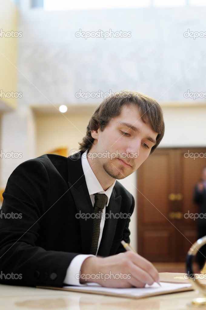 Groom signing marriage license or wedding contract — Stock Photo #10997802