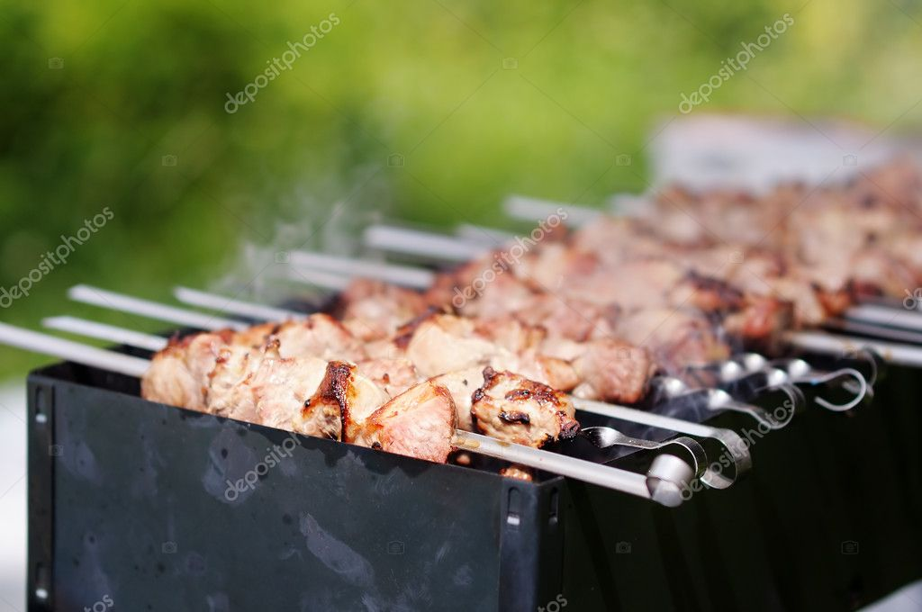 Juicy slices of meat with sauce prepare on fire (shish kebab) — Stock Photo #11708074