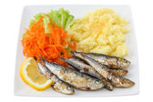 Fried sardines with mashed potato and salad — Photo