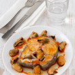 Boiled fish with sauce and mussels on the white plate — Stock Photo #11009037