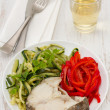 Boiled fish with vegetables and glass of wine — Stock Photo #11009283