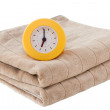 Brown towel with yellow watch on white background — Stock Photo