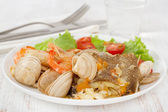 Fish stew with salad on the white plate — Stock Photo