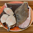 Fresh various fish on plate — Stockfoto #11942551