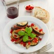 Ratatouille with basil on the white plate - Stock Photo