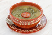 Soup with sausage in the bowl — Stock Photo
