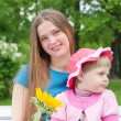 Stock Photo: Little girl and young mother in a park