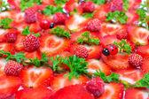 Fresh strawberry slices and ladybugs — Stock Photo