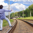 Man hitch-hiking on a train tracks — Stock Photo
