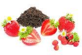 Herbal black tea with strawberry on white background — Stock Photo