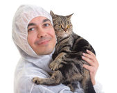 Man in protective clothing holding a cat, isolated — Stock Photo